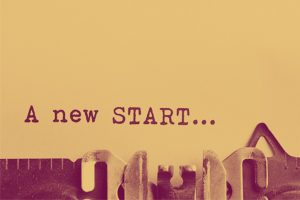 "A sheet of paper in a typewriter with the words ""A new START..."" typed on it"